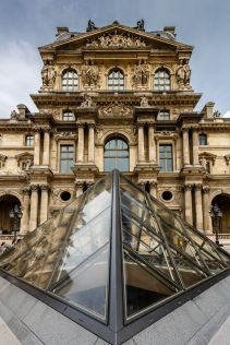 PARIS - JULY 1: Glass Pyramid in Front of the Louvre Museum on July 1, 2013. The Louvre is one of the world's largest museums in Paris. Nearly 35,000 objects are exhibited here.
